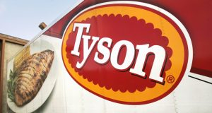In this photo made Wednesday, Oct. 28, 2009, a Tyson Foods, Inc., truck is parked at a food warehouse in Little Rock, Ark. Tyson Foods, the world's largest meat producer, said Monday, Nov. 23, 2009, it lost money in its fiscal fourth quarter primarily on a hefty goodwill impairment charge.(AP Photo/Danny Johnston)