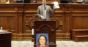 State Sen. Richard Cash, R-Powdersville, speaks on Wednesday in the South Carolina Senate about a bill that would ban almost all abortions in the state. In front of him is a photo of a woman he said was born from a pregnancy caused by rape. The state Senate passed the bill on an initial vote (AP Photo/Jeffrey Collins)