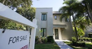 A home for sale is seen Tuesday, Dec. 8, 2020, in Orlando, Fla. U.S. long-term mortgage rates declined this week to new record lows for the first week of 2021. The year opens against the continuing backdrop of damage from the coronavirus pandemic on the U.S. and global economies, which suppressed home loan rates through most of 2020.   (AP Photo/John Raoux)