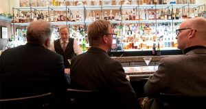 In this Tuesday, Nov. 27, 2018, photo, a bartender talks to a customer at the Gotham Bar and Grill in New York. The Manhattan upscale restaurant hopes to reopen by summer 2021 if government regulations permit, but will likely have just 35 staffers instead of the 100 the restaurant had before it closed in March 2020. (AP Photo/Mary Altaffer)