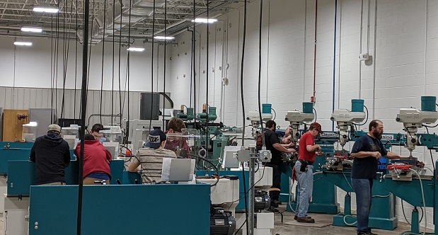 Former Verso Co. paper mill employees work on CNC lathe machines as part of Allegany College's Advanced Manufacturing Program. A makerspace planned for the county is designed to help other displaced workers acquire new skills. (Submitted Photo)