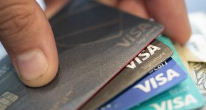 FILE - This Aug. 11, 2019 file photo shows Visa credit cards in New Orleans. Borrowing by Americans fell in January 2021 for the first time in five months, as a big drop in the use of credit cards offset increases in auto loans and student loans. The Federal Reserve reported Friday, March 5, 2021 that consumer borrowing fell by $1.3 billion in January, the first setback since a $9 billion decline in August. (AP Photo/Jenny Kane, File)