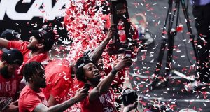Houston players celebrate their 67-61 win over Oregon State during an NCAA men's college basketball tournament game in Indianapolis Monday. A case being argued before the Supreme Court could allow colleges to compensate student athletes. (AP Photo/Michael Conroy)