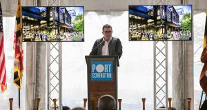 Under Armour Chairman Kevin Plank, with renderings of Port Covington, speaks at the Wednesday event. (Submitted Photo)(
