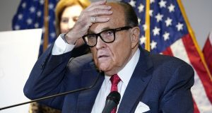 Former New York Mayor Rudy Giuliani, who was a lawyer for President Donald Trump, speaks during a news conference at the Republican National Committee headquarters in Washington on Nov. 19. The U.S. Attorney's Office in Manhattan has returned to the question of whether to bring a criminal case against the former New York mayor, according to people familiar with the case. (AP Photo/Jacquelyn Martin, File)