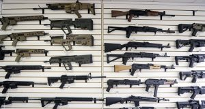 Semi-automatic rifles fill a wall at a gun shop in Lynnwood, Washington. With Democrats controlling the presidency and Congress, Republican state lawmakers in at least a dozen states are working to pass state laws seeks to nullify any new federal restrictions.(AP Photo/Elaine Thompson, File)