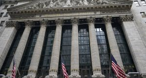 American flags hang outside of the New York Stock Exchange in New York. Corporate profits' freefall because of the pandemic is over, judging from recent earnings reports. (AP Photo/Frank Franklin II, File)