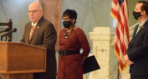 Gov. Larry Hogan with House Speaker Adrienne Jones and Senate President Bill Ferguson Wednesday to announce a bipartisan agreement on a supplemental budget plan for spending $3.9 billion in federal pandemic aid. (The Daily Record/Bryan P. Sears)