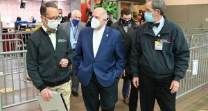 Dr. Chuck Callahan, left, and Dr. James Ficke, the co-directors of the Baltimore Convention Center Field Hospital, give Gov. Larry Hogan a tour of the facility on Feb. 8. (Submitted Photo)