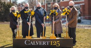 From left, Wendy Griswold, Ben Griswold, Calvert School Head Master Andrew Holmgren, Wendy Bond and Ward Classen participate Wednesday in a ceremonial groundbreaking for the Luetkemeyer Athletic Center. (Photo courtesy of Calvert School)
