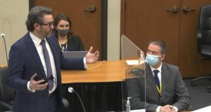 In this image from video, defense attorney Eric Nelson, left, discusses motions before the court as defendant, former Minneapolis police officer Derek Chauvin, right, and Nelson's assistant Amy Voss, back, listen, Monday, April 12, 2021, as Hennepin County Judge Peter Cahill presides over the trial of Chauvin at the Hennepin County Courthouse in Minneapolis. Chauvin is charged in the May 25, 2020 death of George Floyd. (Court TV, via AP, Pool)