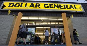 FILE - In this Wednesday, Sept. 25, 2013, file photo, customers exit a Dollar General store, in San Antonio. Dollar General is going hostile with its $9.1 billion bid for Family Dollar after repeated rejections of previous offers by its rival. The discount chain said Wednesday Sept. 10, 2014 that it is offering investors of Family Dollar Inc. $80 per share in cash, the same offer that was rejected last week by the company board. (AP Photo/Eric Gay, File)