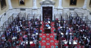 The Maryland Senate meets on the last day of the state's 90-day legislative session on Monday, April 12, 2021 in Annapolis, Md. Senators have been working inside enclosures around their desks as a precaution during the COVID-19 pandemic. By Brian Witte. (AP Photo/Brian Witte)