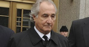 FILE - Bernard Madoff exits Manhattan federal court, Tuesday, March 10, 2009, in New York. Madoff, the financier who pleaded guilty to orchestrating the largest Ponzi scheme in history, died early Wednesday, April 14, 2021,  in a federal prison, a person familiar with the matter told The Associated Press. (AP Photo/ Louis Lanzano, File)