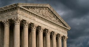 In this June 20, 2019, file photo, the Supreme Court is seen in Washington as a storm rolls in. The Supreme Court has agreed to hear an appeal to expand gun rights in the United States in a New York case over the right to carry a firearm in public for self-defense. (AP Photo/J. Scott Applewhite, File)