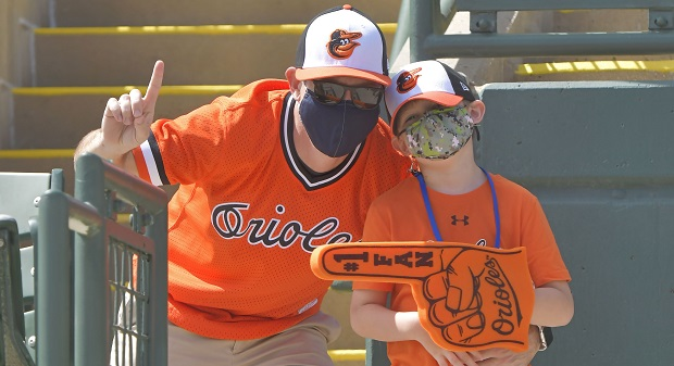Orioles fans pose for a picture at a spring training game in Sarasota, Florida, where a mask mandate was enforced. There are similar precautions in place when the Orioles play their home opener Thursday. (Courtesy of Baltimore Orioles)