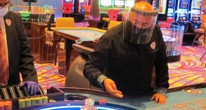 A dealer conducts a game of roulette at the Hard Rock Casino in Atlantic City N.J. on July 2, 2020, the first day the casino was allowed to reopen during the coronavirus pandemic. Figures released on April 9, 2021, show Atlantic City's nine casinos collectively saw their gross operating profits decline by more than 80% in 2020. (AP Photo/Wayne Parry)
