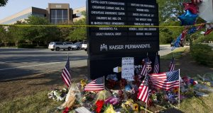 FILE - In this July 1, 2018 file photo a makeshift memorial is seen at the scene outside the office building housing The Capital Gazette newspaper in Annapolis, where a gunman killed five people. (AP File Photo/Jose Luis Magana)