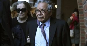 Insys Therapeutics founder John Kapoor, right, departs federal court Thursday, Jan. 23, 2020, in Boston, after he was sentenced to 5 1/2 years in prison for orchestrating a bribery and kickback scheme prosecutors said helped fuel the opioid crisis. He was found guilty the previous May of racketeering and conspiracy in a scheme where millions of dollars in bribes were paid to doctors across the United States to prescribe the company's highly addictive oral fentanyl spray, known as Subsys. (AP Photo/Charles Krupa)