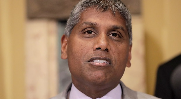 """""""We follow the science, and the scientific evidence tells us that from a safety and efficacy standpoint, COVID-19 vaccines represent a dramatic accomplishment and a clear pathway out of this pandemic,"""" says Mohan Suntha, UMMS' president and CEO. (AP Photo/Julio Cortez)"""