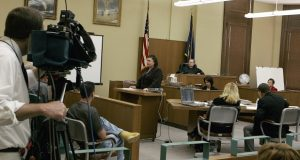 Defense attorney Stephanie Clark, center, presents her opening statement to members of the jury, during the trial of Richard Griswold at the Gage County Court, in Beatrice, Neb., Monday, May 19, 2008. Griswold, 43, of Beatrice, is charged with first-degree murder and use of a weapon to commit a felony in the November death of 49-year-old Connie Eacret of Beatrice. Griswold is not contesting allegations he shot Eacret, but is seeking to have the first-degree murder charge replaced with the lesser charge of manslaughter. In what is believed to be a first for the state, media cameras were being allowed in a courtroom for a criminal trial. It's part of a pilot project supported by the state Supreme Court that could lead to more video and still images of court proceedings across the state that will be distributed by the news media.(AP Photo/Nati Harnik, Pool)