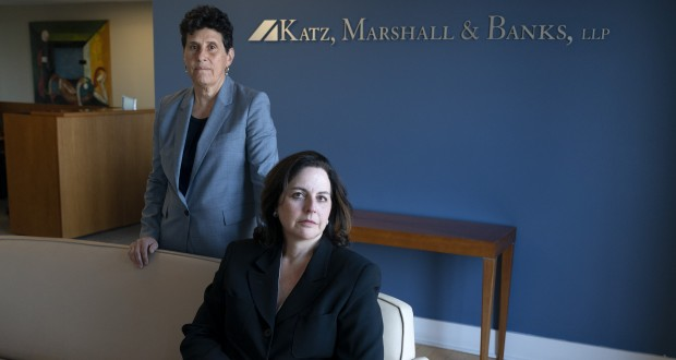 """Civil rights attorneys Debra Katz, left, and Lisa Banks, pose on May 21, 2021, for a portrait at their law firm in Washington. For many people, the pandemic year has brought a pause of some kind, or at least a slowdown, to their professional endeavors. For Katz and Banks, the opposite has been true. """"This is probably the biggest year we've ever had,"""" says Banks. Their work has been increasing for nearly four years. When the Harvey Weinstein revelations erupted in October 2017, launching the reckoning that became known as the #MeToo movement, it caused """"a sea change,"""" Katz says. (AP Photo/Jacquelyn Martin)"""