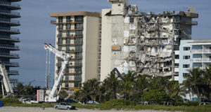 Heavy machinery sits parked in front of the partially collapsed Champlain Towers South condo building, on Thursday, July 1, 2021, in Surfside, Fla.(AP Photo/Mark Humphrey)