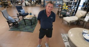 John Hessler, 62, the patio section manager at Valley View Farms in Cockeysville, Maryland, poses for The Associated Press in his showroom on July 6, 2021. (AP Photo/Julio Cortez)