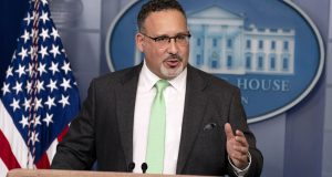 In this March 17, 2021, file photo, Education Secretary Miguel Cardona speaks during a press briefing at the White House in Washington. The U.S. Education Department has announced it will forgive student loans for more than 1,800 borrowers who attended for-profit colleges that made false recruiting claims. (AP Photo/Andrew Harnik, File)