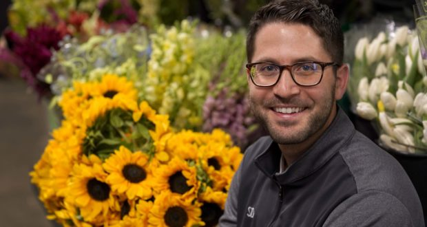 Steven Dyme, owner of Flowers for Dreams, poses for a portrait at his warehouse July 23, 2021, in Chicago. Dyme says the $15 minimum wage made it much easier to staff up when the economy reopened this spring and demand for flowers, particularly for weddings, soared. (AP Photo/Charles Rex Arbogast)