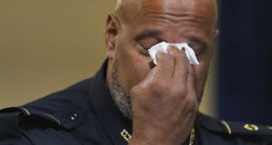 U.S. Capitol Police Sgt. Harry Dunn wipes his eyes during the House select committee hearing on the Jan. 6 attack on Capitol Hill in Washington on Tuesday, July 27, 2021. (AP Photo/ Andrew Harnik, Pool)