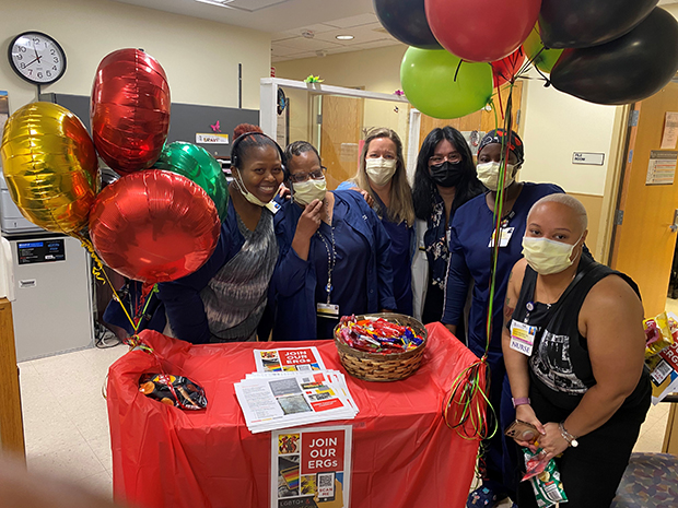Members of the Employee Health Services Department at the University of Maryland Medical Center take time for a photo next to Embraced's roving goodies cart. (Photo courtesy of University of Maryland Medical Center)