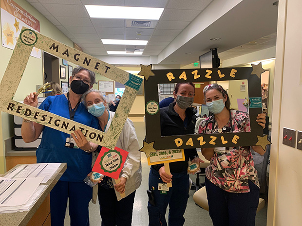 From left, Ann Wilner, Patty Hengel, Melissa Wilson and Jenifer Beaty, nurses from the Inpatient Progress Care Unit, are recognized for achieving Magnet redesignation. (Photo courtesy of Mercy Medical Center)