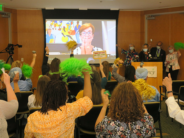 Groups of nurses join together to celebrate by cheering as the chair of the Commission for the Magnet Recognition Program officially announces Mercy's third honor. (Photo courtesy of Mercy Medical Center)