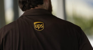 A UPS driver enters a store with packages in Jackson, Mississippi on July 26, 2021. The Atlanta-based company said it plans to hire more than 100,000 people for the busy holiday shipping season, many of whom will get job offers within 30 minutes of applying. (AP Photo/Rogelio V. Solis)