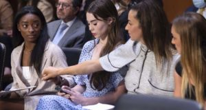 United States gymnasts from left, Simone Biles, McKayla Maroney, Aly Raisman and Maggie Nichols arrive to testify during a Senate Judiciary hearing about the Inspector General's report on the FBI's handling of the Larry Nassar investigation on Capitol Hill on Sept. 15, 2021. Nassar was charged in 2016 with federal child pornography offenses and sexual abuse charges in Michigan. He is now serving decades in prison after hundreds of girls and women said he sexually abused them under the guise of medical treatment when he worked for Michigan State and Indiana-based USA Gymnastics, which trains Olympians. (Saul Loeb/Pool via AP)