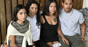 This Sept. 5, 2021, photo shows Erika Erazo, Erica Umana, Dayri Amaya and Brandon Cuevas, who alleged that Prince George's County law enforcement barged into their apartment and tased and killing their dog as well in Landover Hills. Several officers have been suspended and the whole incident is under investigation. (Marvin Joseph/The Washington Post via AP)