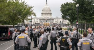 """Police stage at a security fence ahead of a rally near the U.S. Capitol in Washington on Sept. 18, 2021. The rally was planned by allies of former President Donald Trump and aimed at supporting the so-called """"political prisoners"""" of the Jan. 6 insurrection at the U.S. Capitol. (AP Photo/Nathan Howard)"""