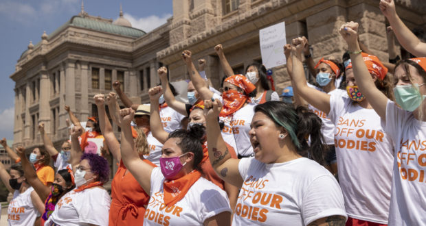 Women protest against the six-week abortion ban at the Capitol in Austin, Texas, on Sept. 1, 2021. A San Antonio doctor who said he performed an abortion in defiance of a new Texas law has all but dared supporters of the state's near-total ban on the procedure to try making an early example of him by filing a lawsuit. (Jay Janner/Austin American-Statesman via AP, File)