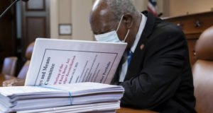 Rep. Danny Davis, D-Ill., looks over documents on Sept. 14, 2021, as the tax-writing House Ways and Means Committee continues working on a proposal for tax hikes on big corporations and the wealthy to fund President Joe Biden's $3.5 trillion domestic rebuilding plan, at the Capitol in Washington.. (AP Photo/J. Scott Applewhite, File)