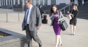 Attorneys and staff associated with a federal trial of pharmacies, CVS, Walgreens, Giant Eagle and Walmart, leave the Carl B. Stokes Federal Courthouse in Cleveland on Oct. 4, 2021. The pharmacies are being sued by Ohio counties Lake and Trumbull for their part in the opioid crisis. (AP Photo/Phil Long)