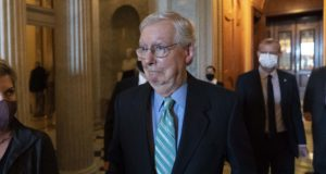 Senate Minority Leader Mitch McConnell of Ky., walks to a policy luncheon on Capitol Hill on Oct. 7, 2021, in Washington. (AP Photo/Alex Brandon)