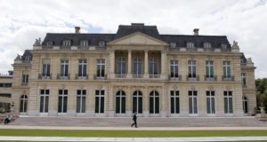 In this June 7, 2017 file photo, the Organisation for Economic Co-operation and Development (OECD) headquarters is pictured in Paris, France. Nearly 140 countries have agreed on a tentative deal that would make sweeping changes to how big, multinational companies are taxed in order to deter them from stashing their profits in offshore tax havens where they pay little or no tax. The agreement announced Friday foresees countries enacting a global minimum corporate tax of 15% on the biggest, internationally active companies. (AP Photo/Francois Mori, File)