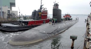 In this Friday, July 30, 2004, file photo, the U.S.S. Virginia returns to the Electric Boat Shipyard in Groton, Connecticut, after its first sea trials. A Navy nuclear engineer with access to military secrets has been charged with trying to pass information about the design of American nuclear-powered submarines to someone he thought was a representative of a foreign government but who turned out to be an undercover FBI agent, the Justice Department said Oct. 10, 2021. (AP Photo/Jack Sauer, File)