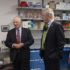 U.S. Sen. Ben Cardin, D-Md, left, U.S. Rep. David Trone, D-6th-Md., center, and Seth Lederman, Tonic CEO, chat in a lab area of the Tonix Pharmaceuticals facility after a ribbon cutting ceremony Oct. 18, 2021, in Frederick. Tonix Pharmaceuticals officially has a research and development center for infectious diseases — and it's located in Frederick, right down the road from the city's municipal airport. (Bill Green/The Frederick News-Post via AP)