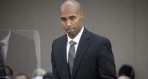 Mohamed Noor makes his way to the podium to address Judge Kathryn Quaintance at the Hennepin County Government Center, Thursday, Oct. 21, 2021 in Minneapolis. The Minneapolis police officer, who fatally shot an unarmed woman after she called 911 to report a possible rape happening behind her home, was sentenced Thursday to nearly five years in prison — the most the judge could impose but less than half the 12½ years he was sentenced to for his murder conviction that was overturned last month. (Elizabeth Flores/Star Tribune via AP, Pool)