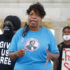 """In this Friday, Sept. 4, 2020, file photo, activist Gwen Carr speaks during a Black Lives Matter rally in front of Boardwalk Hall, in Atlantic City, New Jersey. On Oct. 25, 2021, a rare judicial inquiry began into the death of Eric Garner, whose dying cry of """"I can't breathe"""" as he was restrained by New York City police officers became a slogan of the Black Lives Matter movement. Garner's mother, Carr, and other activists sought the inquiry hoping it would create a measure of public accountability for his 2014 death. (AP Photo/Noah K. Murray, File)"""